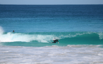 blue ocean, turquoise clear face offshore wind blowing the white wash behind the wave, Dan covered up in barrel