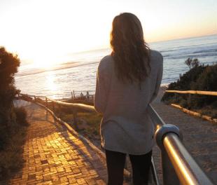 Tegan watching the sunset over Yallingup beach