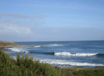 Surf at Jakes Point Kalbarri, blue skies with a few patchy clouds, nice wave breaking