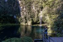 Tegan and Dan kissing at the platform over the bay at the falls, water streaming behind us