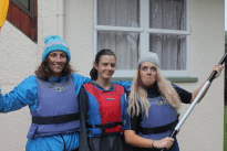 Tegan, Nina and Seane dressed and lifejackets on ready for the kayaking