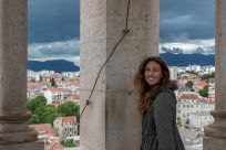 Tegan in the bell tower, storm clouds behind