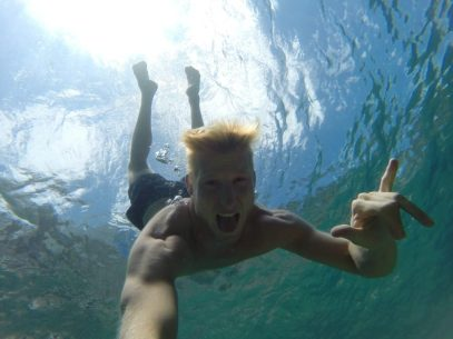 Dan underwater selfie and a shaka sign