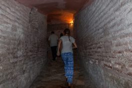 Tegan walking up the ramp inside the hagia sophia, looks like a tunnel