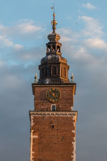 Clock tower with grey clouds behind