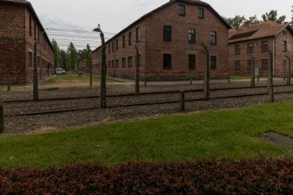 Looking in to Auschwitz from outside the fence