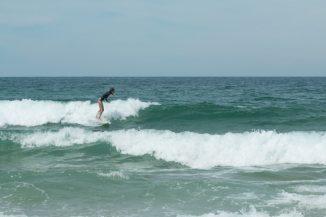 Tegan surfing