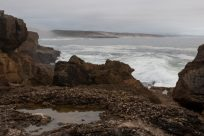 Rock pool with the wave breaking behind