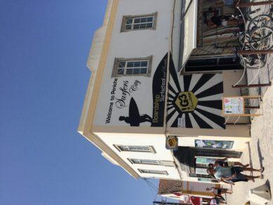 Welcome to Peniche, Surfers City on the white building in Peniche
