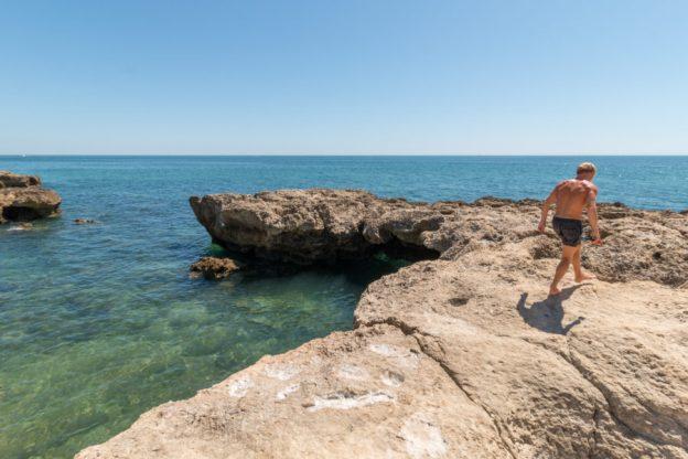 Daniel walking the rocks of the coast