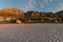 Table mountain bathed in golden light from the sunset