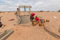 Standing by the water well for the nomads in the desert