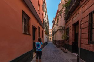 Tegs walking a narrow street