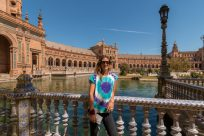 Tegs standing in front of the plaza de espana