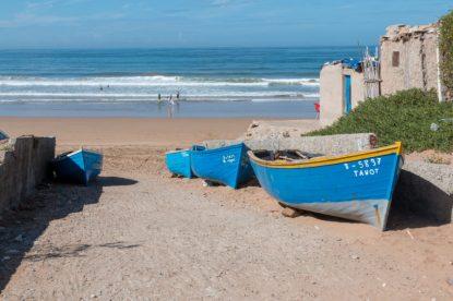 Blue boats on banana beach