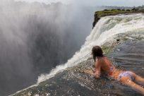 Dan holding Tegans legs as she peeps over the edge