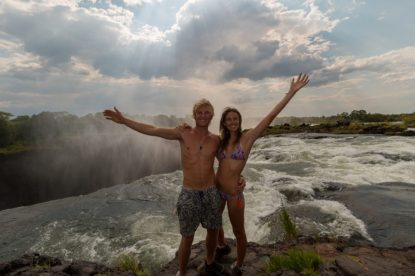 Half hug, half arms outstretched in front of devils pool