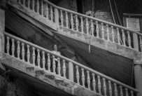 Black and white pic of Tegan in the stairs