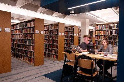 Students conduct research in the library