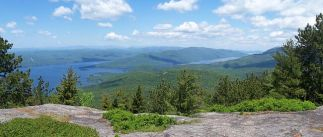 """Betsy can't say enough about opportunities for outdoor recreation in our area. She says, """"The Adirondack Mountains are the reason I moved here and the reason I continue to love living here. If you're a hiker, biker, climber, or skier, this is a heavenly place to be! I recommend working on one of our local hiking challenges, like the Saranac Lake 6er, Adirondack Fire Tower Challenge, or if you're more advanced, becoming a 46er. You'll discover places you never knew existed and have some incredible adventures along the way!"""""""