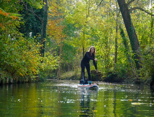 Stand up Paddler on her inflatable SUP in Spreewald
