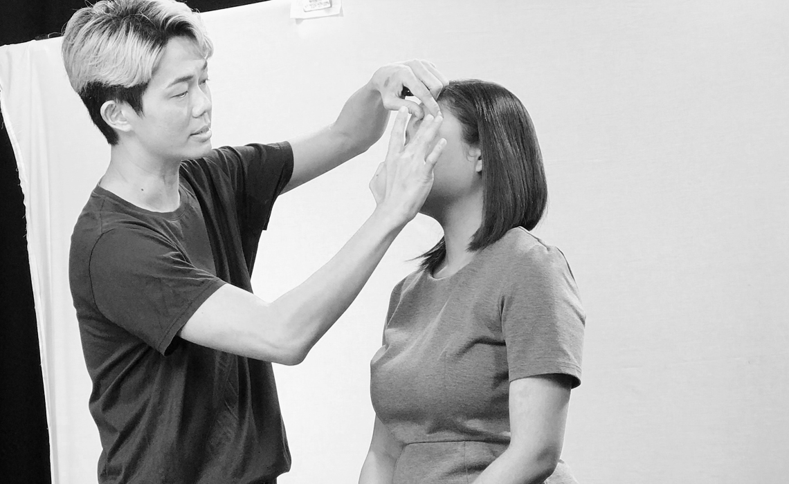 Superbly's co-founder and makeup educator Larry Yeo working his makeup magic at photo shoot.