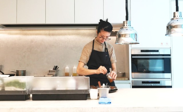 Chef Lisa Tang plates her creations in an open kitchen decked out in upscale American brands Sub-Zero and Wolf.