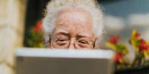 Elderly woman looking at iPad