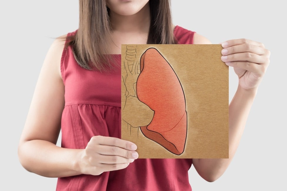 Girl holding a drawing of a lung