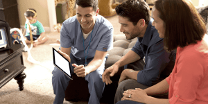 Healthcare practitioner talking with couple