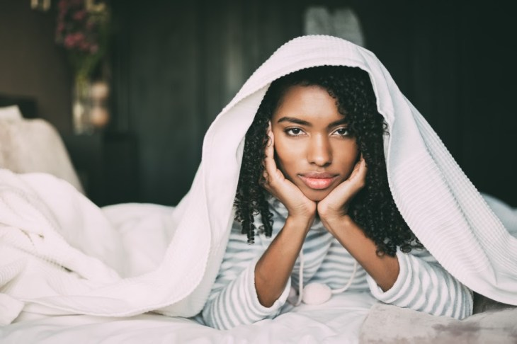 african american woman wellness sleep healthy lifestyle in bed stressed