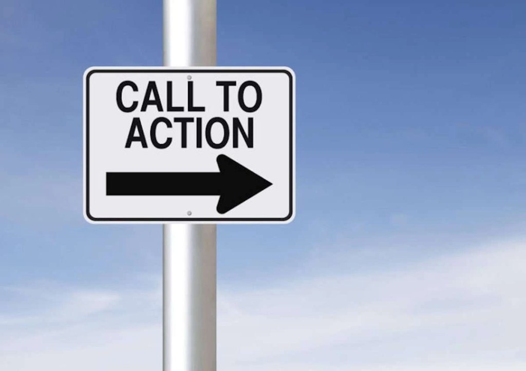 """Photo of a modified one-way road sign that has a big arrow pointing right with text above it that says, """"CALL TO ACTION."""""""