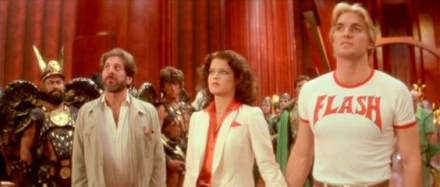 Chaim Topol as Dr. Zarkov, Melody Anderson as Dale, and Sam J. Jones as Flash Gordon.