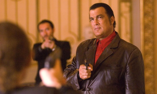 Is Seagal just too lazy to hold a gun properly?