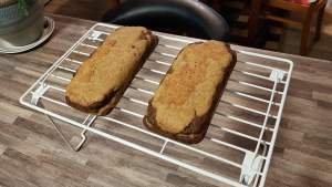Cooked seitan bacon on drying rack