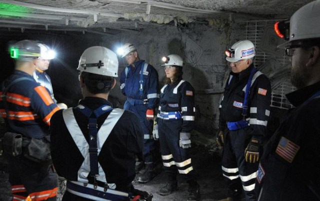 Mine experts discussion in an underground mine