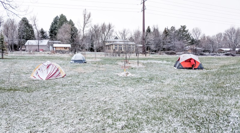 field with tents covered with snow