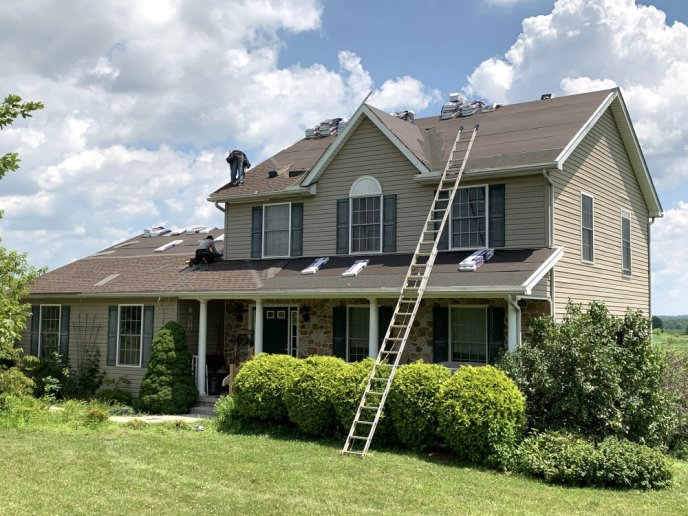 Roofing Contractor in Littlestown PA 17340 executing a roof replacement after wind damage insurance claim approved