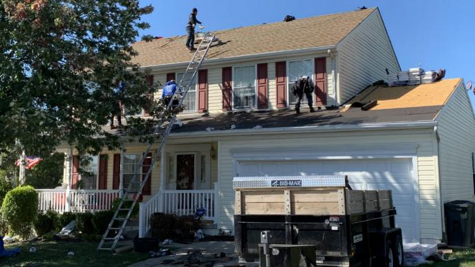 Roofing contractor Superior Services of PA & MD executing a roof replacement in Manchester Maryland 21088. Asphalt shingle roofer.