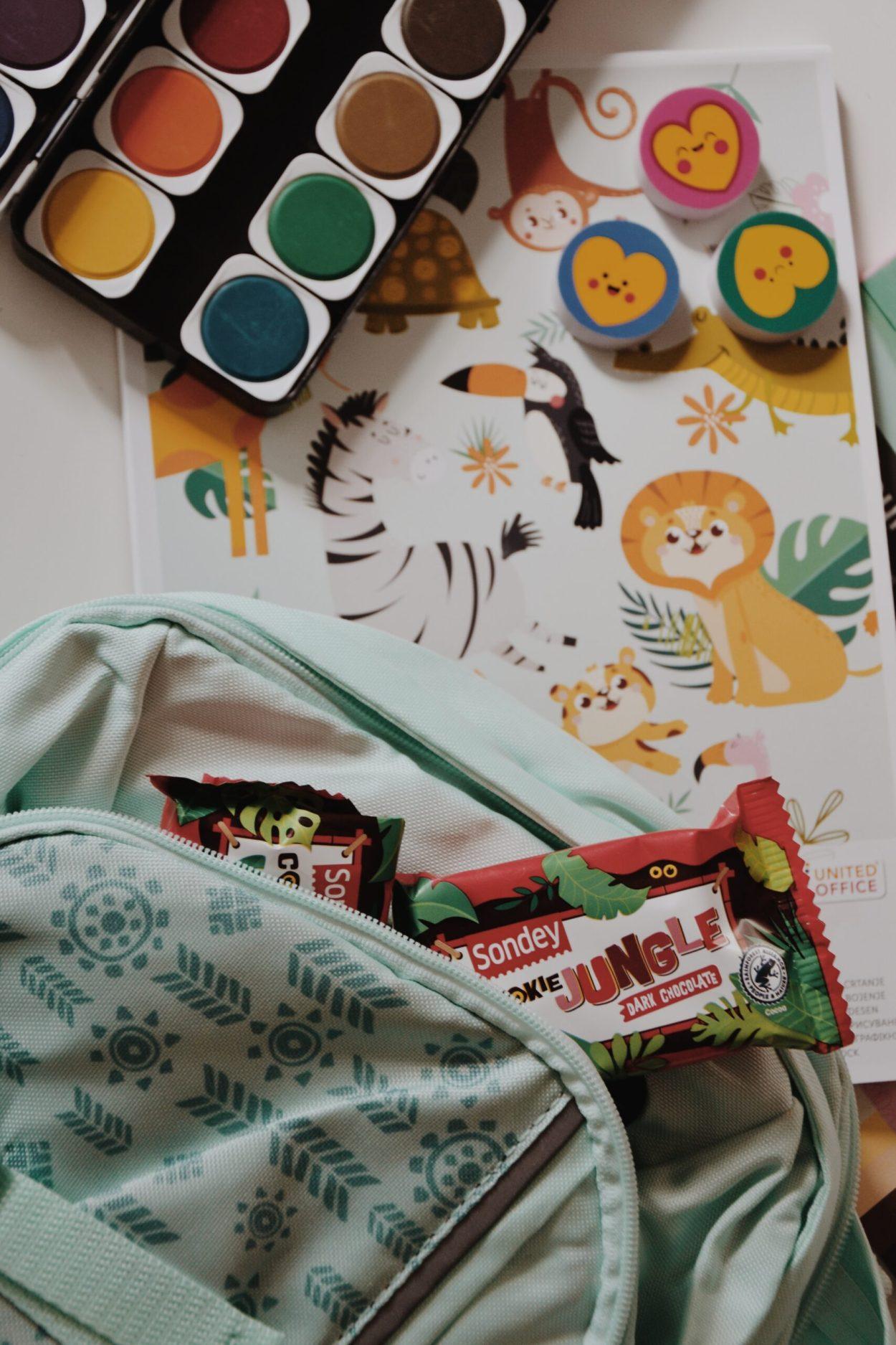 ruksak TOPMOVE 99,99kn; Jungle keksi s tamnom čokoladom 9,99kn; gumice za brisanje 4,99kn; vodene bojice 19,99kn: blok za crtanje11kn