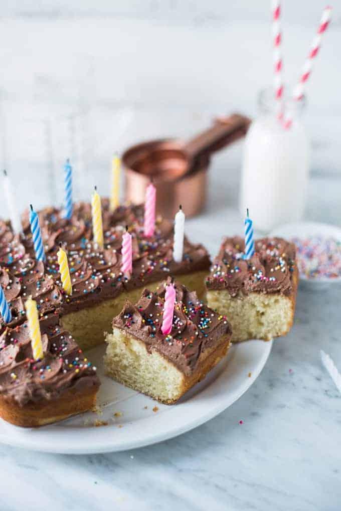vanilla birthday cake + chocolate buttercream frosting | superman cooks