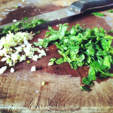 Meanwhile chop some basil and garlic.