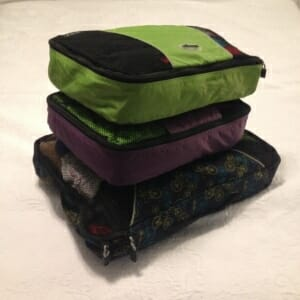 Despite the recent arrival of frigid winter temps, I still managed to pack enough warm layers for a five-day trip to my mom's in three packing cubes: a large one for me, and medium ones for each of the girls. To save space, we're wearing the bulkiest item when we travel.