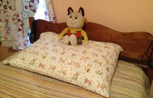 Kimmie's neatly-made bed