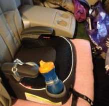 The purple bag on the right has Kimmie's road-trip stash ready; this pic also shows her old leakproof sippy plus leash.