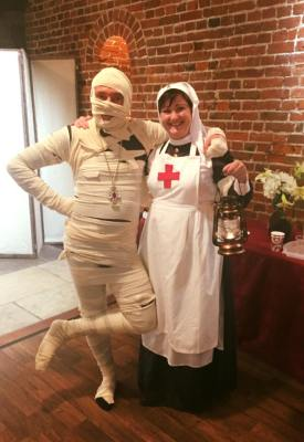 Photo of audience members in fancy dress as a mummy and nurse at the Day of the Dead event during Portsmouth DarkFest 2017