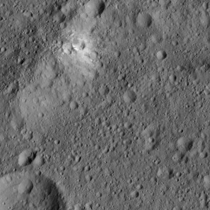 The rim of Kerwan crater, the largest on Ceres. It shows a patch of bright material, one of many on Ceres, thought to be a salt deposit.