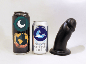 Vixen Creations Randy dildo and soda pop can comparison. The girth of the Vixen Randy is about the same as the top of a soda can.
