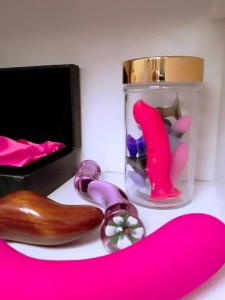 Hard material sex toys, plus a jar of teeny weenies / tiny dildos from Funkit Toys.