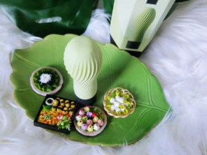 Iroha Zen Matcha on leaf plate, above view. The very tip is a smooth circle, and the squishy pleats extend around it